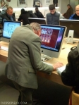 Old man looking at porn on an iMac at the Apple store
