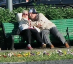 Old people getting busy on a public bench