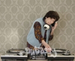 Old lady Dj on the turntables